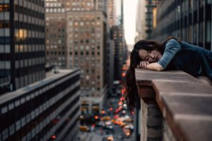 A girl on a small balcony of a high rise