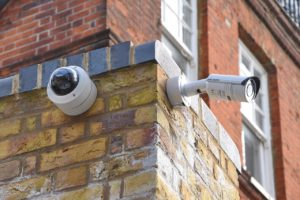 Two CCTV's attached to a wall