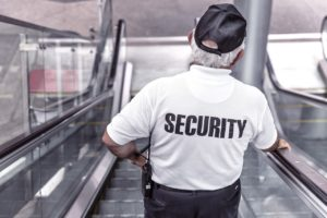 A security officer on the escalator