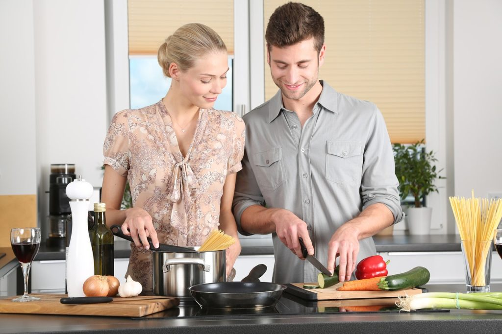 A couple preparing a healthy meal on their kitchen table